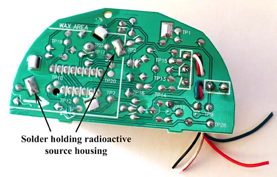 Picture of the back side of the circuit board .  You will have to break the solder to remove the radioactive source housing