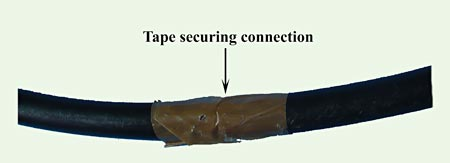 Tape is wrapped around a tube to secure where two pieces of tubing meet