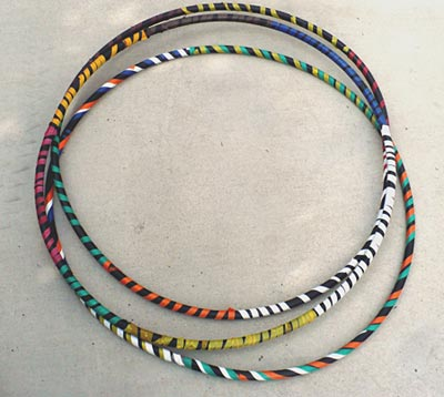 Homemade hula hoops decorated with colorful tape and ready to use to investigate the physics of hula hooping.