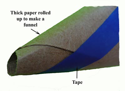 Make a funnel from thick paper and tape (blue tape was used to make it visible, but any tape works).