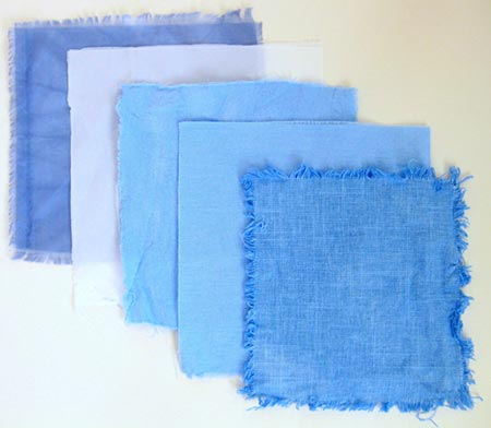 Chemistry science project : Colors that five different types of fabrics become when dyed with the same blue dye.