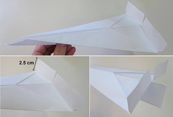 Image of a paper plane with flaps up to increase drag.