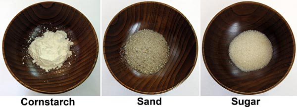 Materials Science project Picture showing bowls of sand, sugar, and cornstarch.