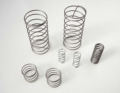 Metal springs of various sizes stand next to each other