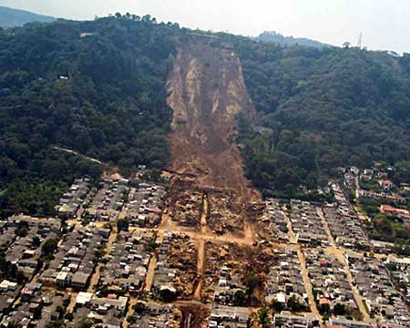 Aerial photo of a landslide that has buried blocks of houses in the town of Colonia Las Colinas