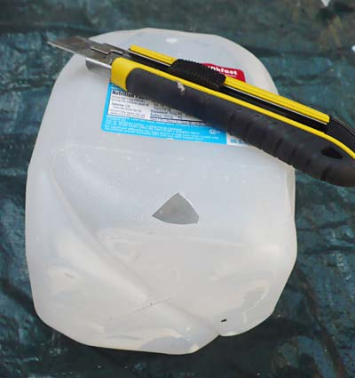 Geology science project  A gallon jug with the top removed using a utility knife