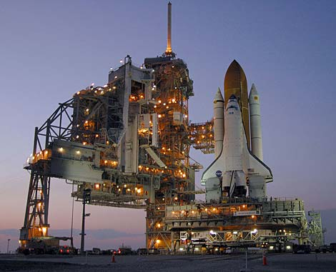 Photo of a NASA space shuttle on a launch pad