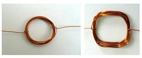 Copper wire coiled in the shape of a circle on the left and the shape of a square on the right