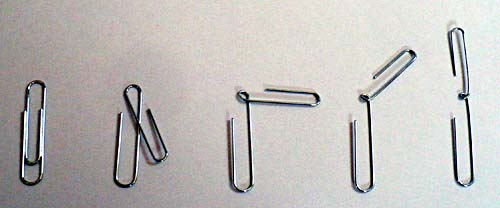 A paperclip is carefully bent inward to create two hooked sides