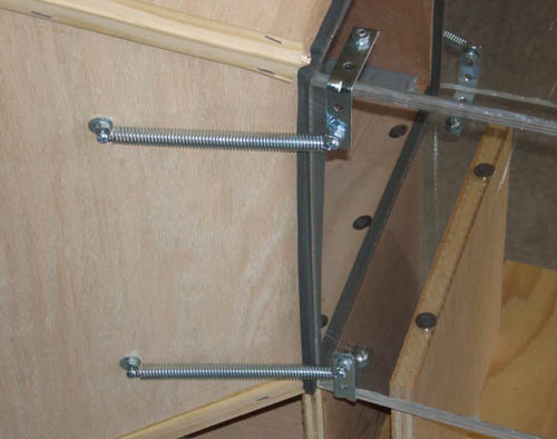 Metal springs hold a Plexiglas box to the back of a contraction cone
