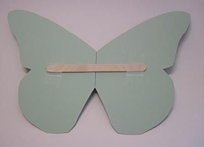 craft stick butterfly to stabilize butterfly wings