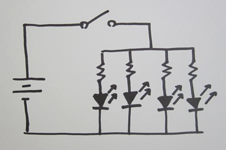Drawing of a circuit with a battery, switch and four LEDs in parallel