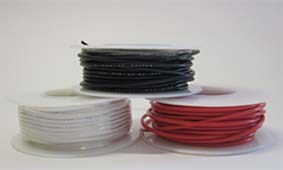 Three spools of red, black and white hookup wire