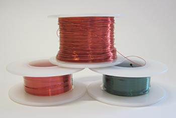 Three spools of red, orange and green magnet wire