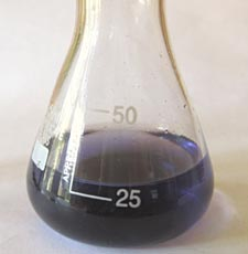 Flask of solution with blue-black completed titration reaction.