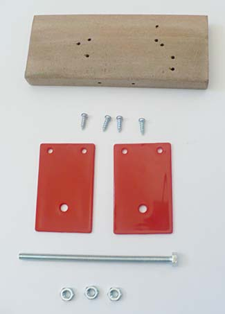 A wooden block, four screws, a long bolt, two plastic panels, and three nuts
