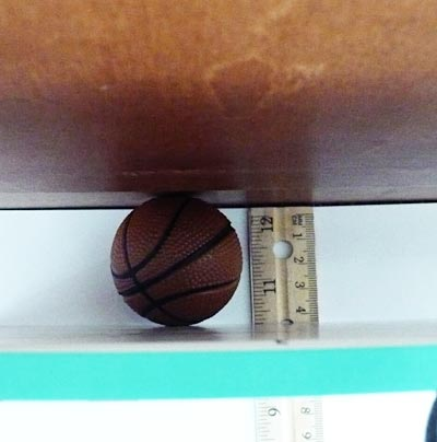 Placing your test ball between a wall and a book allows you to accurately measuring its diameter