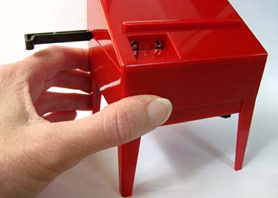 Picture of a hand on the theremin for tuning.