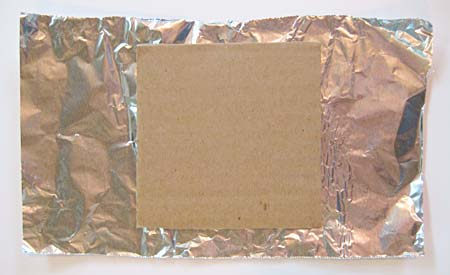 Cardboard square on aluminum foil for making the theremin playing wand.