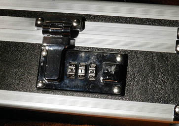 A built-in three digit combination lock on a breifcase