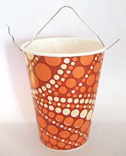 A paper cup with a paperclip attached to the top.