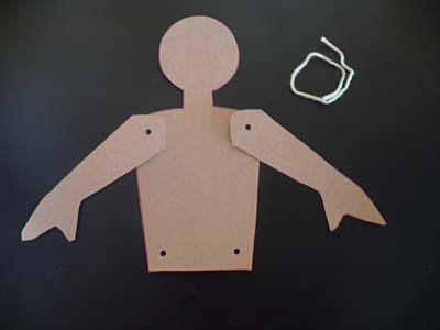 Aligning card stock body parts to attach with yarn