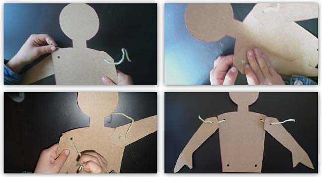Threading yarn through punched out holes in card stock cut-outs of body parts