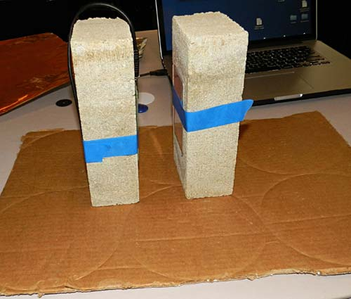 An RFID tag and reader are taped to two bricks facing each other with a small space separating both