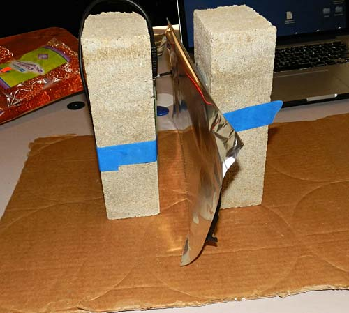 A sheet of aluminum foil is placed between an RFID tag and an RFID reader which are both taped to bricks
