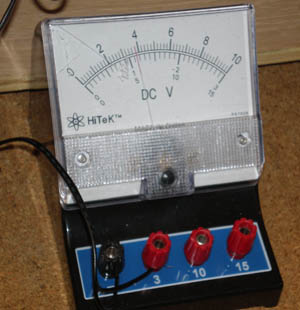 Two lead wires connect to a voltmeter