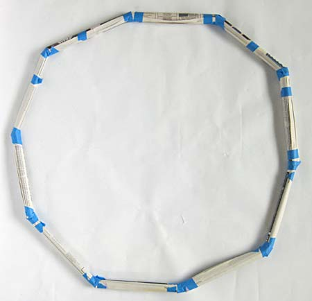 Newspaper tubes taped together to form a circle