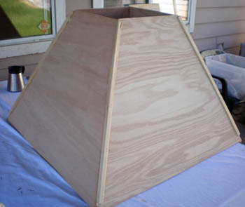 Wooden corner guards are stapled to the corners of a contraction cone where the side panels meet