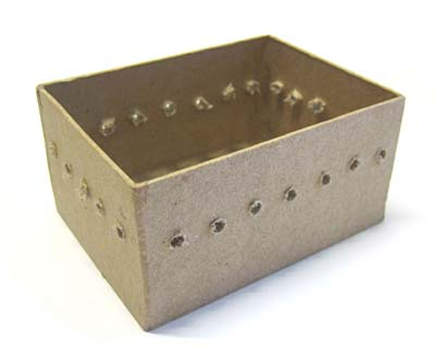 holes drilled in paper mache box