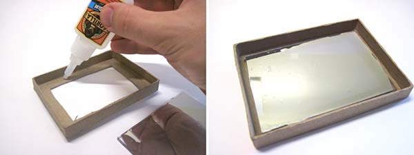 A plexiglass mirror is glued to the inside of a box lid with the mirror side facing inward