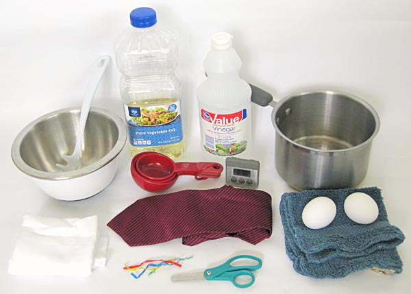 Photograph of materials needed to dye eggs using silk ties.