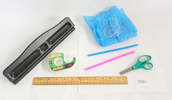 Photograph of the materials needed to test how well a homemade sled kit flies with different length tails.