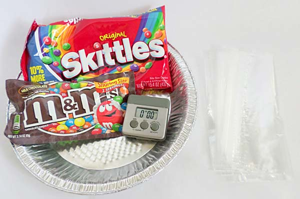 Materials for a science activity using candy to teach camouflage.