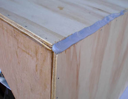 Polyurethane sealant is used to seal the corners and edges of a wooden box