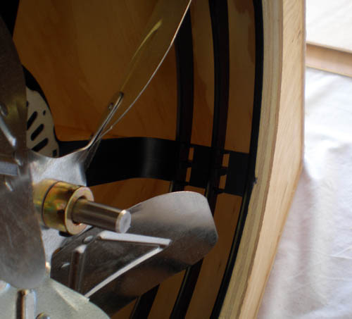 Close up photo of a fan mounted in a wooden box