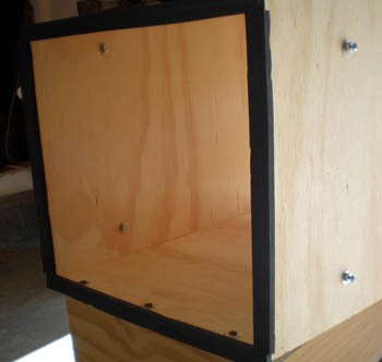 Rubber gaskets cover the edges and corners of a wooden box