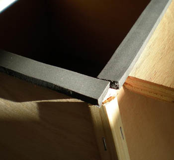 Rubber gaskets completely cover a corner of a wooden box