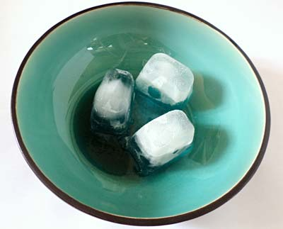 Three ice cubes in a bowl.