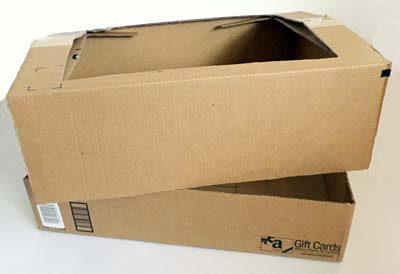 A cardboard box is split into a base and a lid