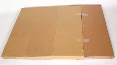 A cardboard lid is created from a sheet of cardboard and tape