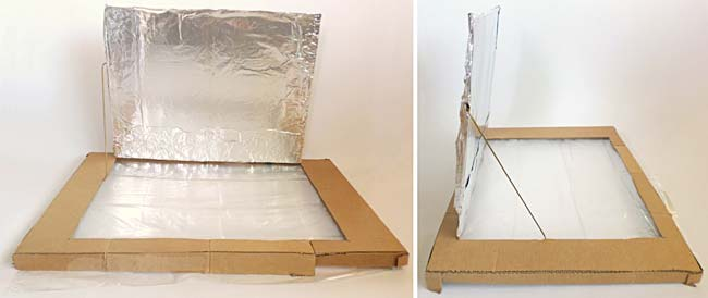A coat hanger wire is used to hold open a flap in the lid of a cardboard box