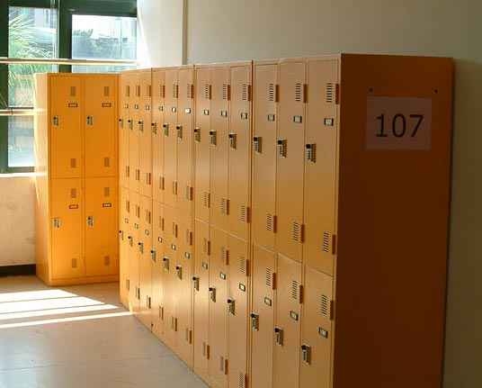 Rows of yellow metal lockers in a hallway