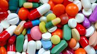 A pile of colorful prescription pills.