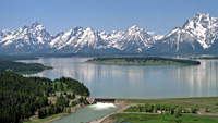 Jackson Lake Dam rimmed by snowy mountains.
