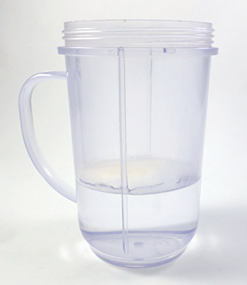 Sodium alginate is added to a blender cup filled with half a cup of distilled water