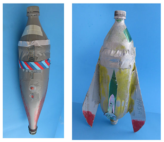 Water bottle rockets painted with spray paint, colored sand, decorative tape, and stickers.